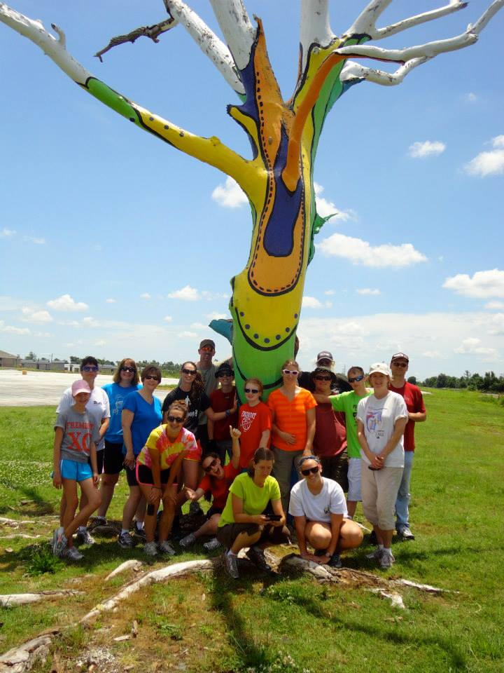 Youth mission trip group at the healing tree
