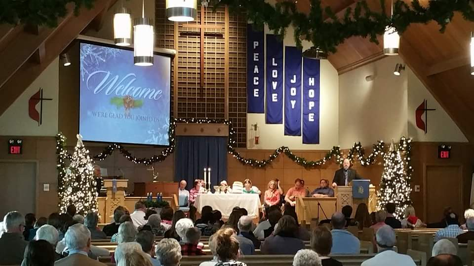 Our Traditional Worship in the sanctuary decorated at Christmas.