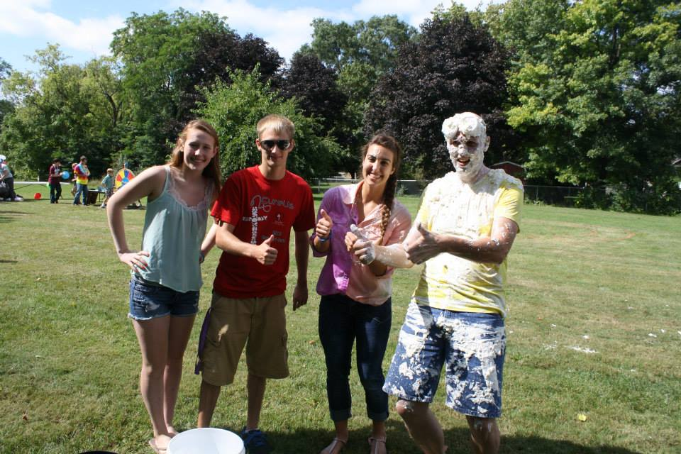 a few of youth and youth leader after pies at the pastor